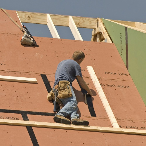 construction site workers on a roof